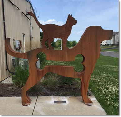 Decorative wooden cutout of a dog and a cat.