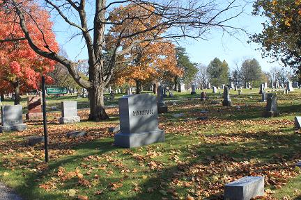 Cemetery section showing monuments and trees with fall colors