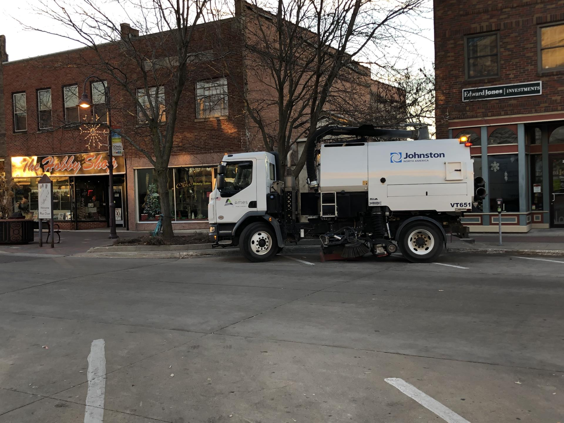 City of Ames street cleaner cleaning Main Street.