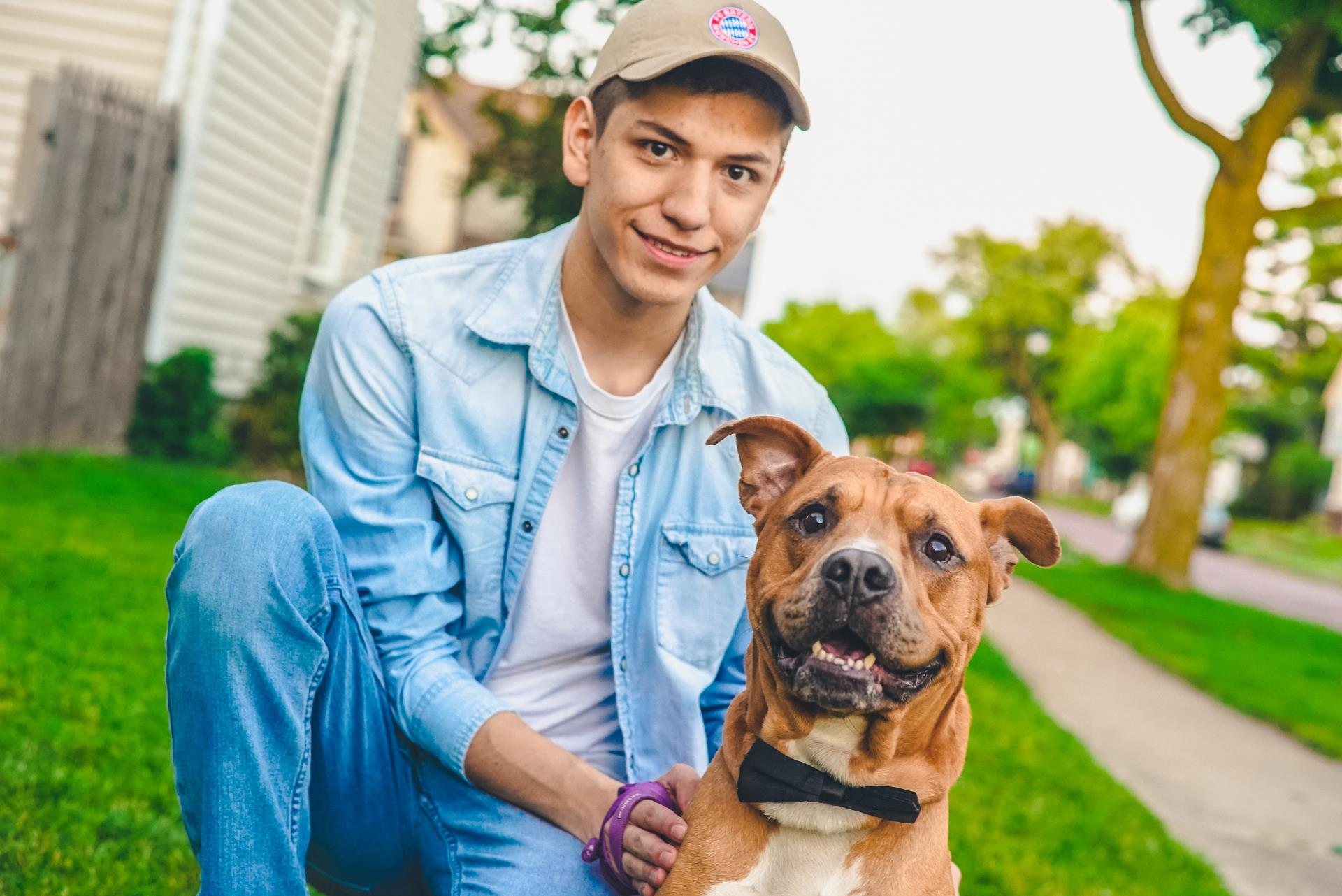 A young volunteer posing with a dog
