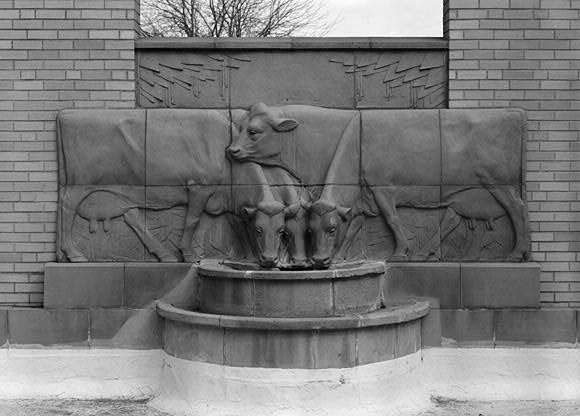 Sculpture of dairy cows drinking water at Christian Petersen Courtyard & Dairy Industry Building at ISU Campus