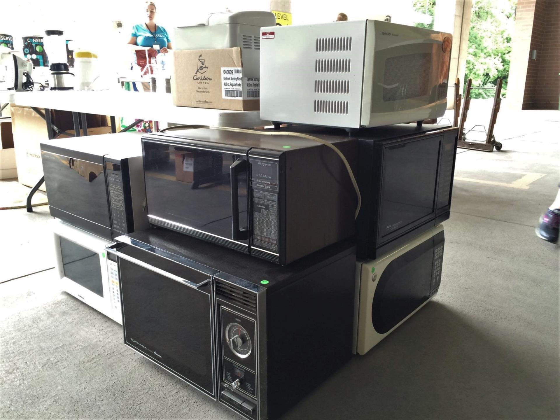 Stack of microwaves for sale at Rummage RAMPage