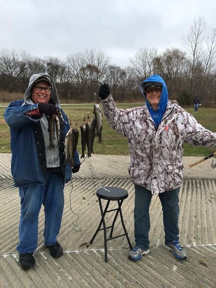 Two people display trout caught during Trout Stocking event in 2017
