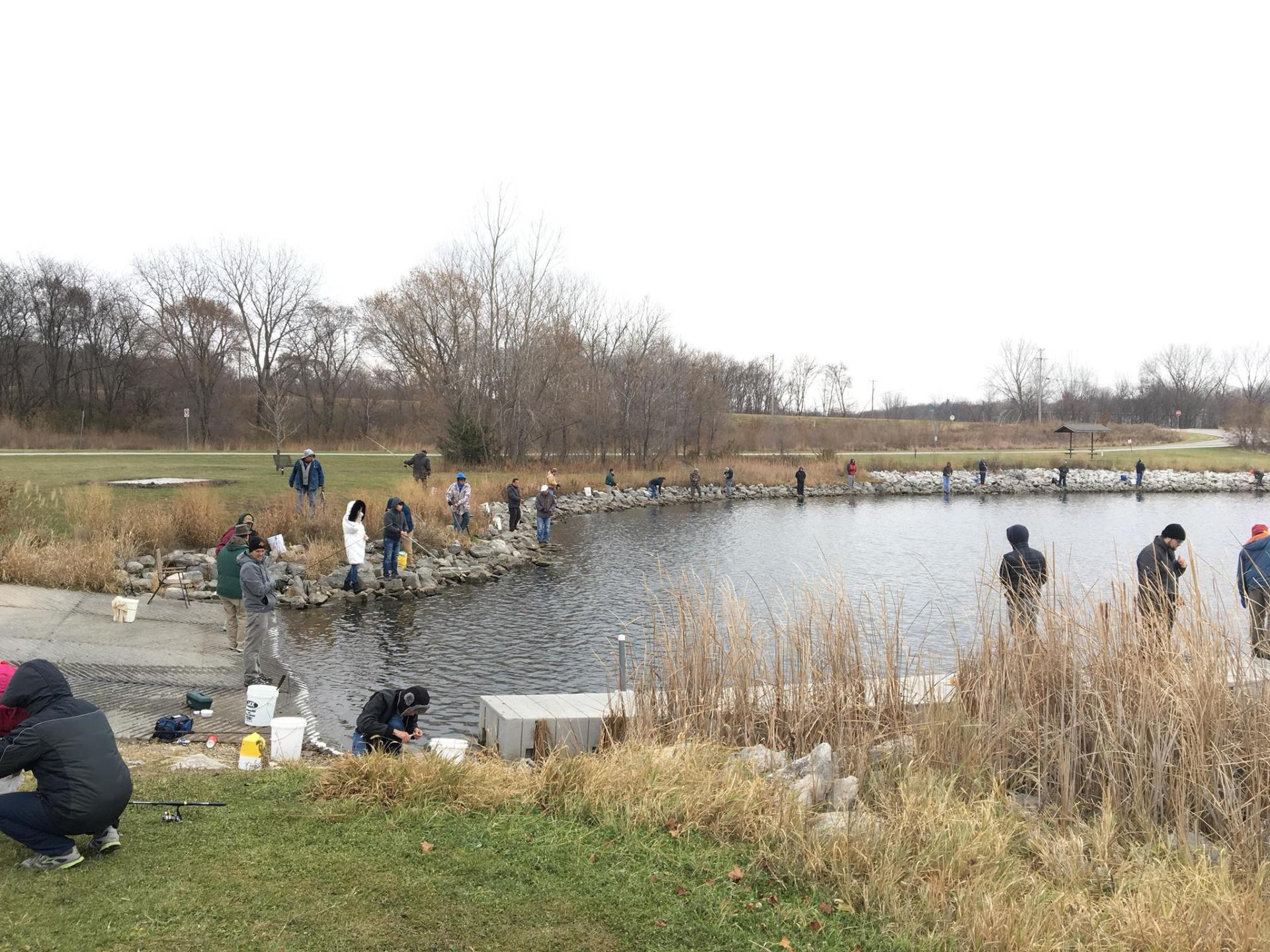 People fishing at Ada Hayden Heritage Park after Trout Stocking event in 2017