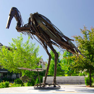 Blue Heron with Sunfish sculpture by Judd Nelson