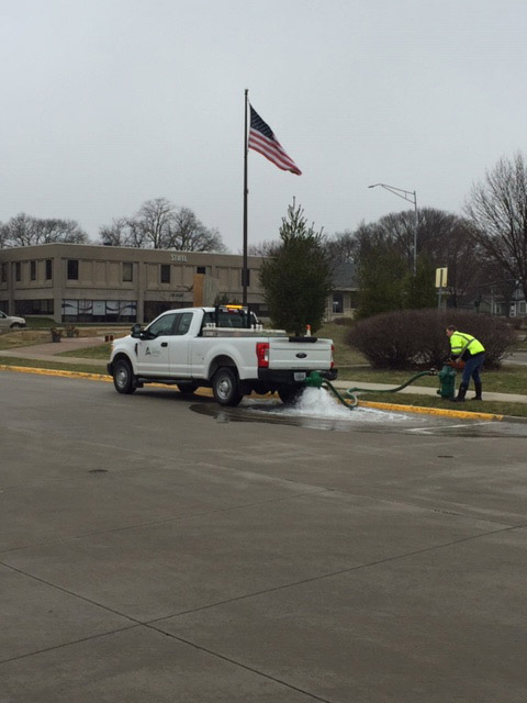 City truck performing hydrant flushing