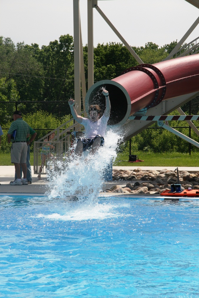 A child coming out of the tube water slide at the Furman Aquatic Center