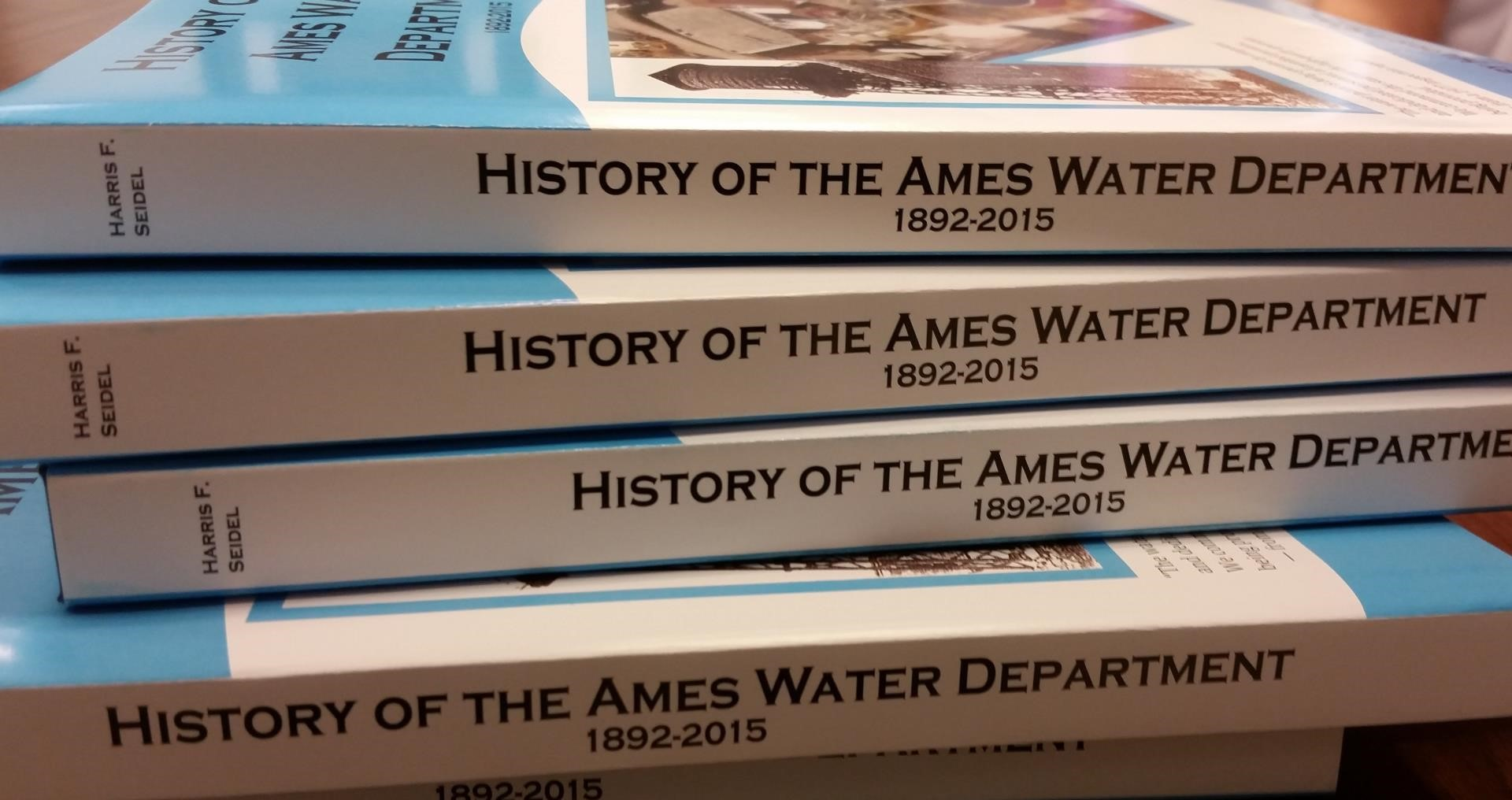 Stack of History of the Ames Water Department books