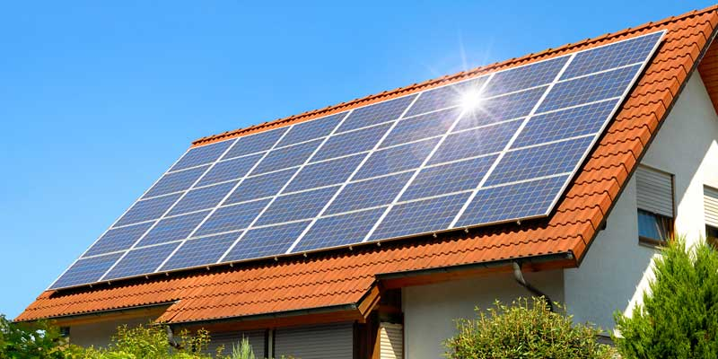 Solar Panels Mounted on Rooftop of House